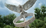 Photo of a statue of a bird. Link to Join The Compass Society.