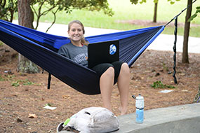 Photo of a student in a hammock. Link to Gifts That Protect Your Assets